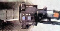 Переключатели панели приборов на левой ручке руля